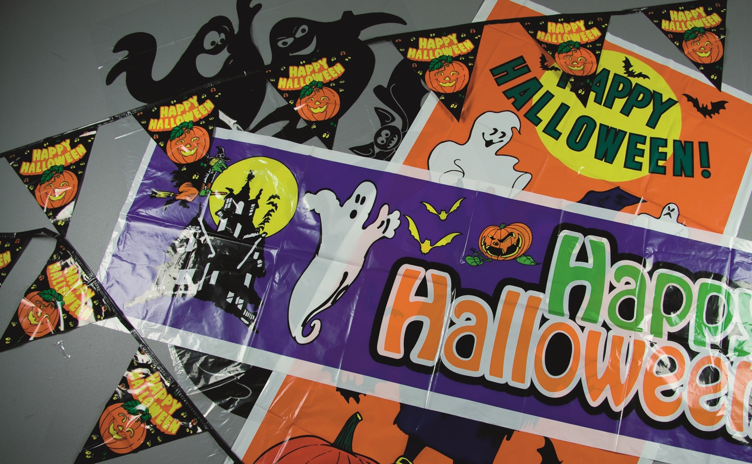 Wholesale Box of 200 Mixed Halloween Decorations - Banners, Tablecloths, Stickers and More