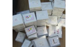 Quantity of `White cotton card' Celebration gift boxes and photo albums