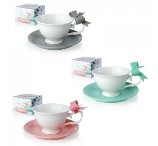 26 sets of tea cups + plate with bow