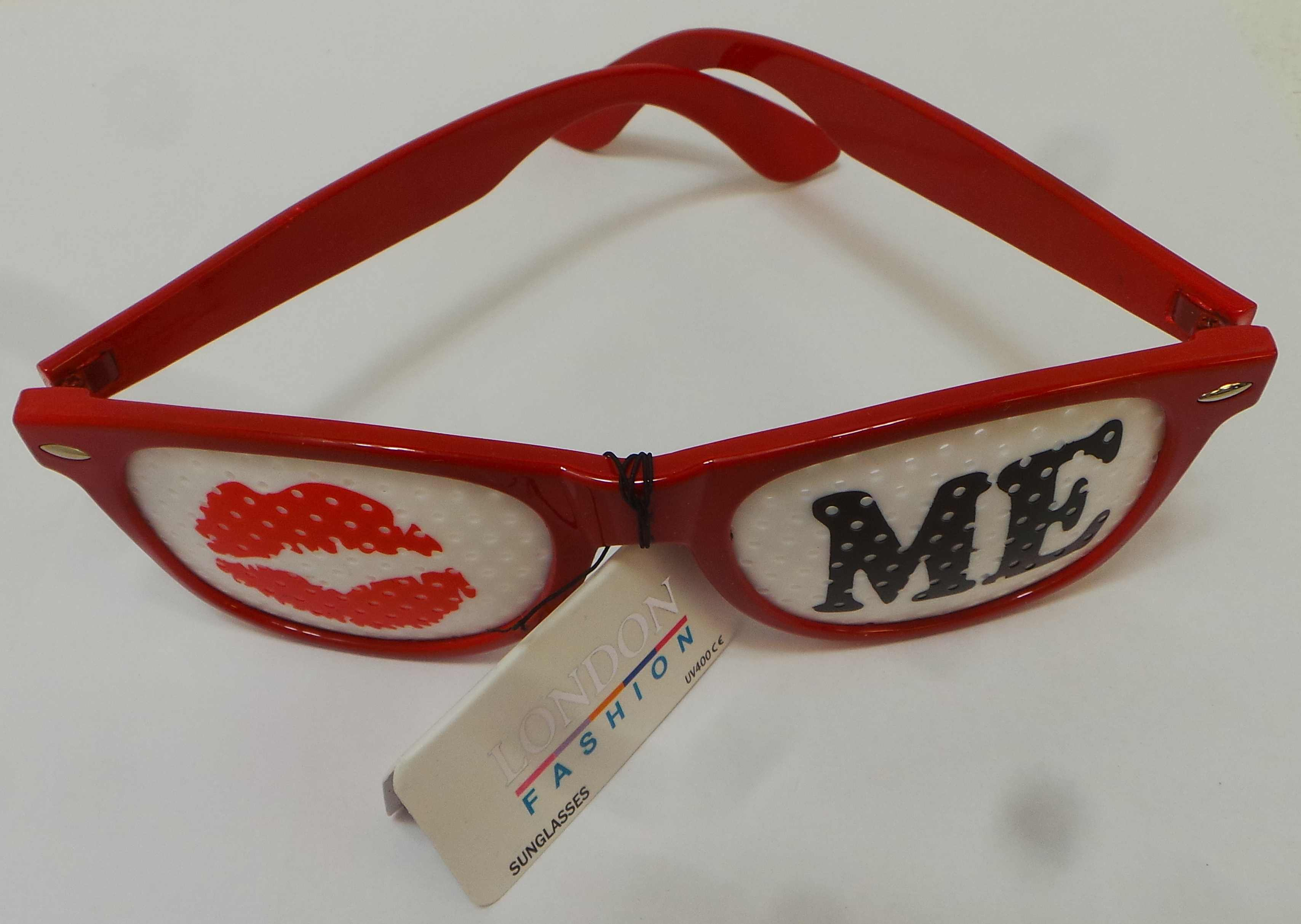 7e90b176906 Each pair comes with a London Fashion tag. Bold red plastic frames. Each  pair of kiss me glasses ...